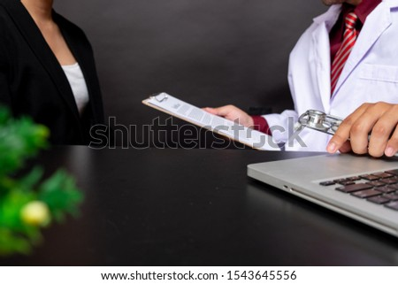 Doctor consulting patient closeup. medical service, consultation or education, healthy lifestyle concept