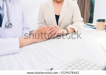 Doctor consulting patient hands closeup. medical service, consultation or education, healthy lifestyle concept