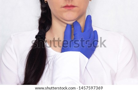 Doctor cosmetologist plastic surgeon holding a young girl for a double chin, problem, medical, portrait, face Foto stock ©