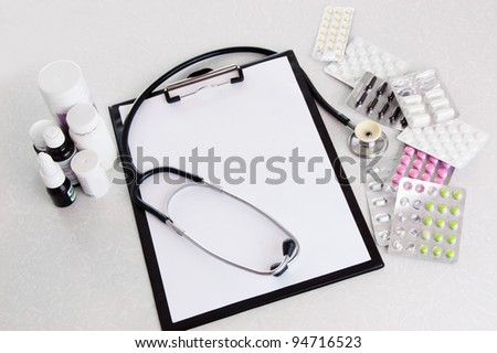 Doctor desk workplace stethoscope, notebook with blank copy space