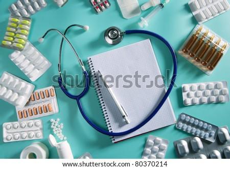 doctor desk workplace stethoscope spiral notebook blank copyspace