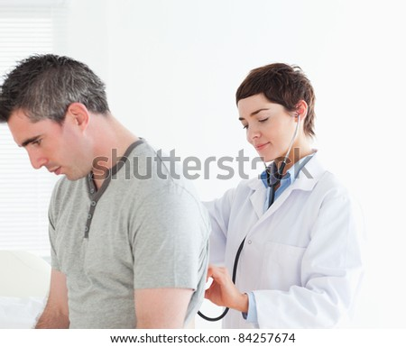 Doctor examining a male patient in a room