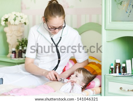 doctor examining girl with stethoscope
