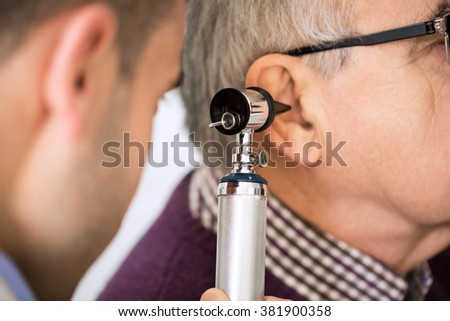 Doctor Examining old Patient's Ear #381900358