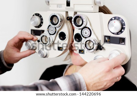 doctor examining patient at the eye clinic