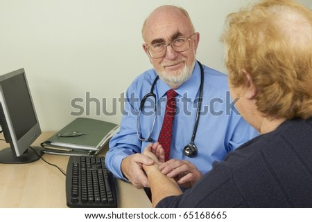 Doctor examining patient in his office