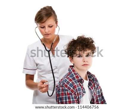 Doctor examining young boy isolated on white background