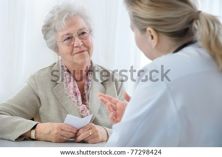 doctor explaining diagnosis to his female patient