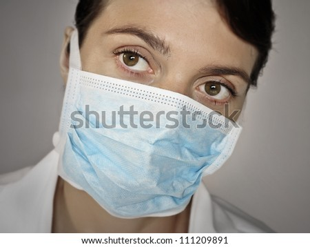 doctor face with a surgical mask