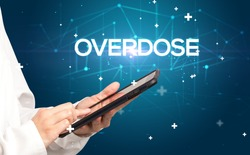 Doctor fills out medical record with OVERDOSE inscription, medical concept