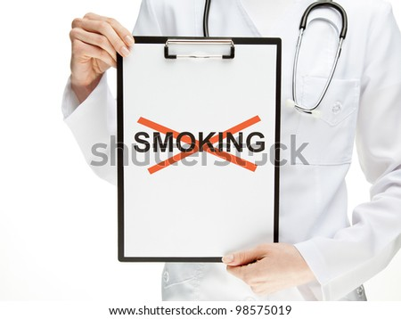 "Doctor forbidding smoking; closeup of doctor's hands holding clipboard with crossed word ""smoking""; healthy lifestyle concept isolated on white"