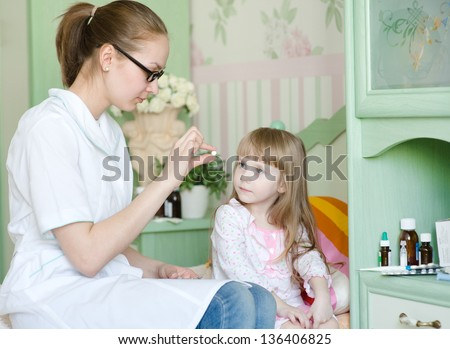 doctor gives a drug to the child