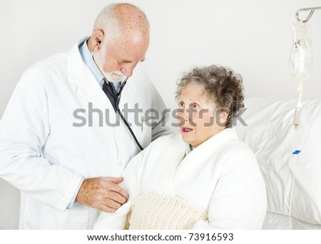 Doctor gives his hospital patient a medical examination.