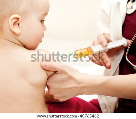 Doctor giving a child a huge injection in arm, shallow DOF
