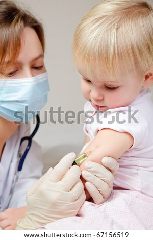 Doctor giving a child an intramuscular injection in arm