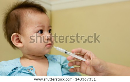 doctor giving her son flu aspirin