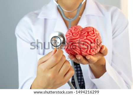 Doctor Hand Holding Brain . The importance of early diagnosis Concept