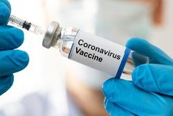 Doctor Hand In Gloves Holding Coronavirus Vaccine