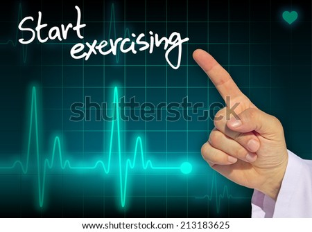 Doctor hand writing message START EXERCISING with heart rate monitor in the background