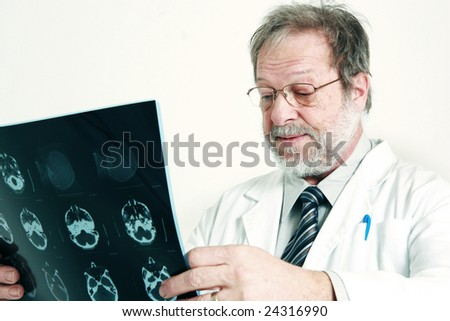 Doctor having a look on head radiography