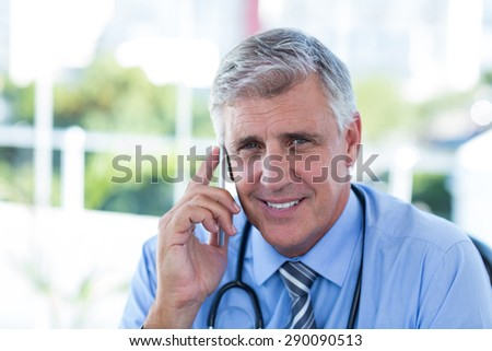 Doctor having phone call in medical office