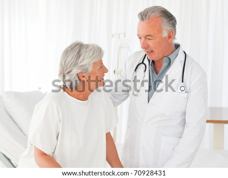 Doctor helping his patient to walk
