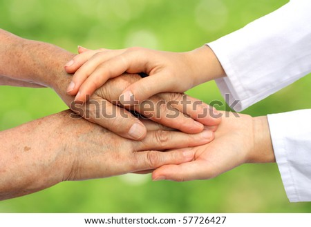 Doctor helping senior in nature