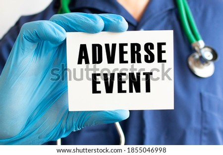 Doctor holding a card with text ADVERSE EVENT. Medical concept. Stock photo ©