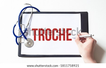 Doctor holding a card with text TROCHE, medical concept Zdjęcia stock ©