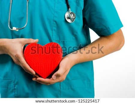 doctor holding a heart symbol  on white background
