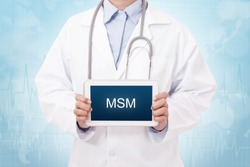 Doctor holding a tablet pc with MSM sign on the display