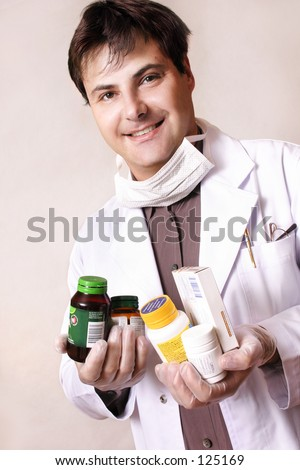 Doctor holding a variety of medicines and supplements