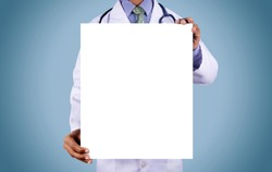 Doctor holding card with stethoscope isolated on color background