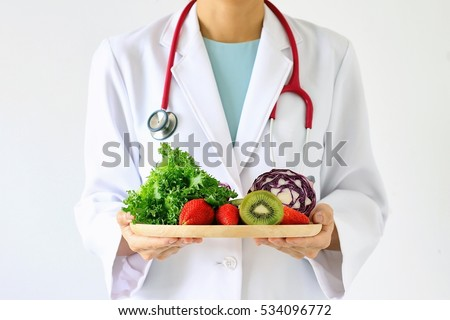 Doctor holding fresh fruit and vegetable, Healthy diet, Nutrition food as a prescription for good health. (Selective Focus)