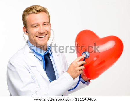 Doctor holding heart on white background