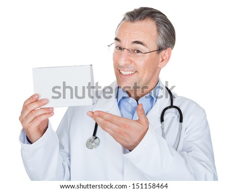 Doctor holding prescription note isolated on white background