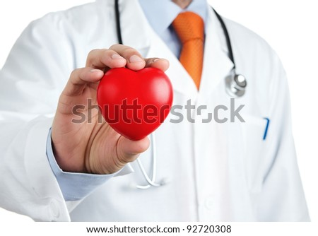 Doctor holding red rubber heart in his hand