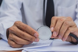 Doctor holding stethoscope  guarantees treatment of disease absolutely safe