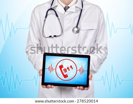 doctor holding touch pad with 911 symbol on a blue background