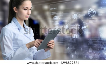 doctor holding touchscreen tablet #1298879521