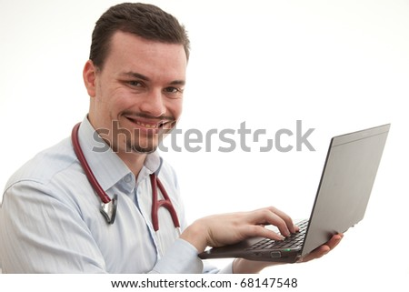 doctor holding up a laptop typing on it