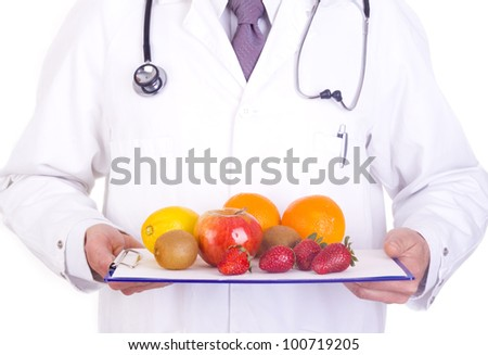 doctor holdingfresh fruit