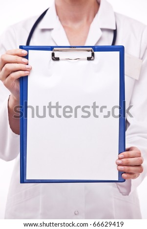 Doctor holds clipboard with empty sheet. Isolated on a white.