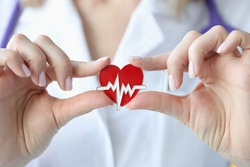 Doctor holds in his hands an icon with cardiogram of heart. Heart and vascular disease concept