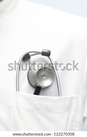 doctor in a white coat with a stethoscope in his pocket.