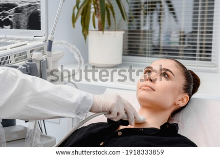 Doctor in diagnostic center making ultrasound thyroid gland test. Ultrasound of thyroid gland Stock photo ©