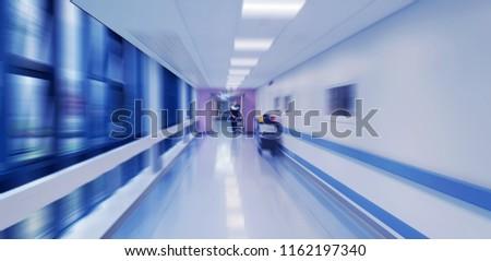 Doctor in hospital corridor, zoom blurred background. #1162197340