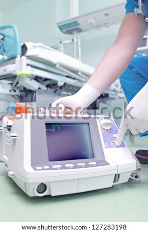 Doctor in ICU with advanced equipment.