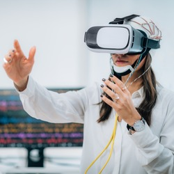 Doctor in Neuroscience Lab with Female Patient Wearing VR or Virtual Reality Goggles