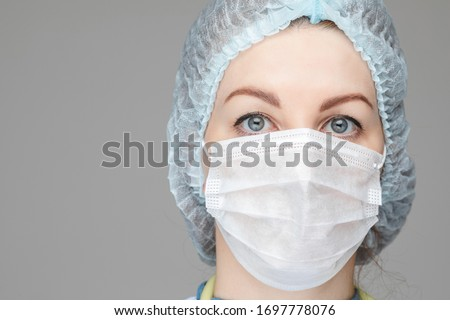 Doctor in PPE looking at camera. Real heroes of our time. Stok fotoğraf ©